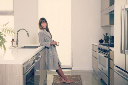 Woman in gray bathrobe.