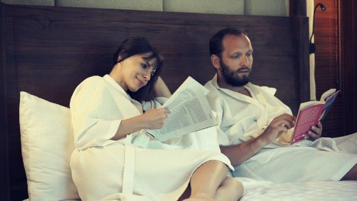 Wife and husband in bathrobe at home.