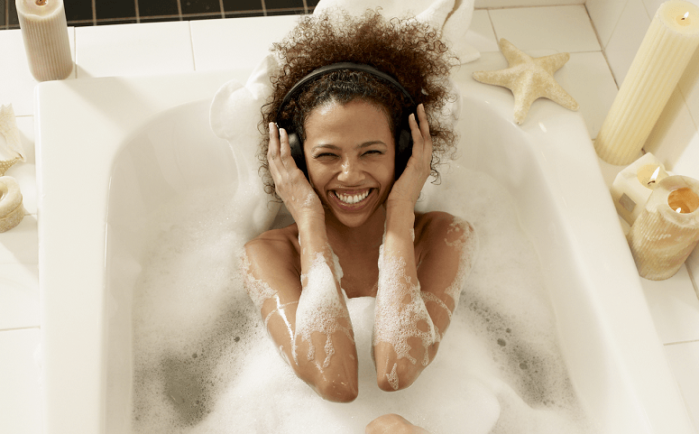 Woman Listening To Music While Bathing